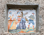 Religious scene, Jesus and Cross, tiled art, Esterri d'Aneu, Pyrenees mountains, Catalonia, Spain.
