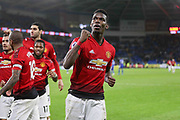 Manchester United Midfielder Paul Pogba salutes the fans punching the air during the Premier League match between Cardiff City and Manchester United at the Cardiff City Stadium, Cardiff, Wales on 22 December 2018.