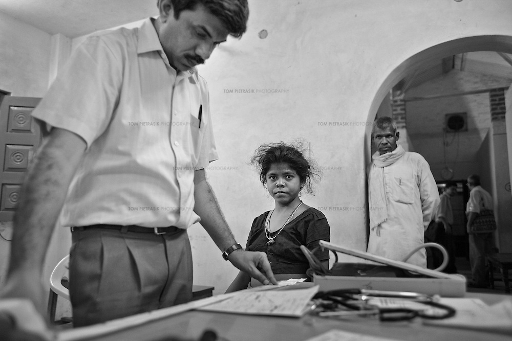 At the end of a day long day examining out-patients at the JSS hospital in Ganiyari, Dr. Yogesh Jain refers to a report on a patient with fluid retention in her abdoment as she looks on. The more complicated cases are often not diagnosed until towards the end of the day by which time the JSS doctors will have had time to discuss symptoms and compare their thoughts on individual patients.<br />