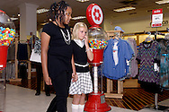 LaRashia Simone Edwards of Trotwood (left,) and Faith Ehring of Centerville during a fashion show at the Elder Beerman store in the Dayton Mall, Saturday, August 14. 2010..