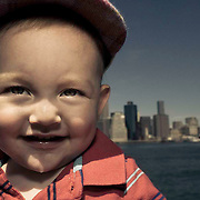 A 14-month-old Caucasian toddler standing in front of the NYC skyline in Brooklyn Bridge Park located in Brooklyn, NY.