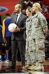 16 November 2015: A game ball gets awarded to a pair of female Army ROTC members. Illinois State Redbirds host the Morehead State Eagles at Redbird Arena in Normal Illinois (Photo by Alan Look)