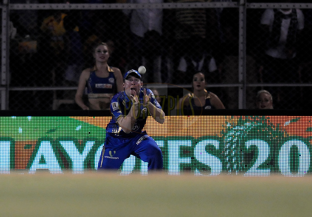 Ben Dunk of the Mumbai Indians takes a catch to get the wicket of Faf du Plessis of The Chennai Superkings during the eliminator match of the Pepsi Indian Premier League Season 2014 between the Chennai Superkings and the Mumbai Indians held at the Brabourne Stadium, Mumbai, India on the 28th May  2014<br /> <br /> Photo by Pal PIllai / IPL / SPORTZPICS<br /> <br /> <br /> <br /> Image use subject to terms and conditions which can be found here:  http://sportzpics.photoshelter.com/gallery/Pepsi-IPL-Image-terms-and-conditions/G00004VW1IVJ.gB0/C0000TScjhBM6ikg