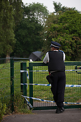 © licensed to London News Pictures. 29/05/2012. London, UK. A olice officer guarding the entrance to a field in Woodford Green, London where the body of an 18-year-old was found on. Photo credit: Tolga Akmen/LNP
