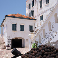 The exterior of the former officers quarters and the entrance to the dungeons at Cape Coast Castle, a UNESCO World Heritage Site located along the Gold Coast of Ghana.