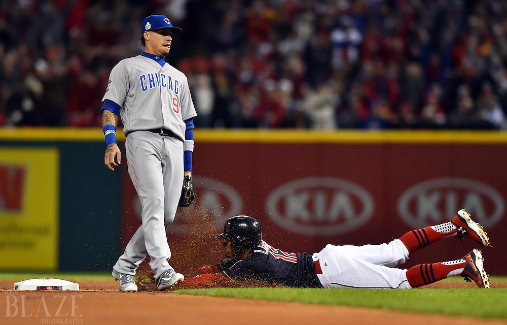 Oct 25, 2016; Cleveland, OH, USA; Cleveland Indians shortstop Francisco Lindor (bottom) steals second base without a throw to Chicago Cubs second baseman Javier Baez (9) in the first inning in game one of the 2016 World Series at Progressive Field. Mandatory Credit: Ken Blaze-USA TODAY Sports