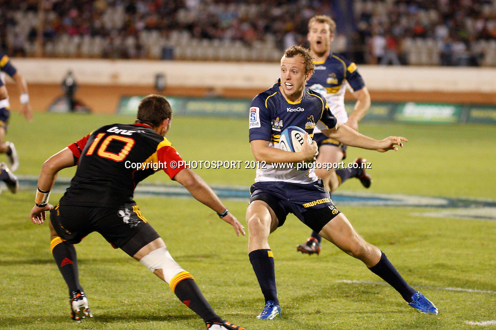 Brumbies fullback Jesse Mogg puts the step on Chiefs Aaron Cruden during their game at Baypark Stadium, Mt Maunganui, New Zealand. Friday,16 March 2012. Photo: Dion Mellow/photosport.co.nz
