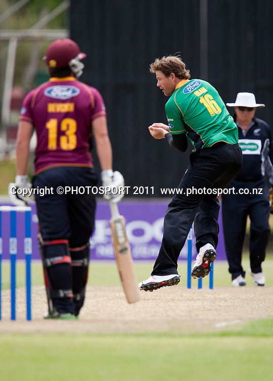 Stag's Jacob Oram bowls and catches Anton Devcich during the Ford Trophy Cricket - Northern Knights v Central Stags one day match, at Seddon Park, Hamilton, New Zealand, 11 December 2011. Photo: Stephen Barker/photosport.co.nz