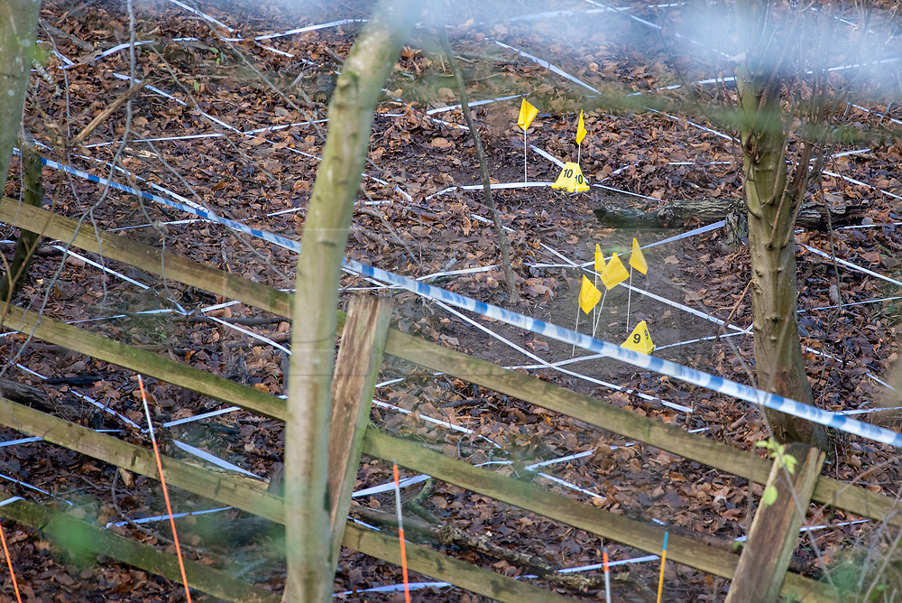 "© Licensed to London News Pictures. 11/12/2019. Gerrards Cross, UK. Police tape and evidence identification markers on woodland floor as the Metropolitan Police Service continues a search operation in Gerrards Cross, Buckinghamshire. Police have been in the area conducting operations since Thursday 5th December 2019. In a press statement issued on 7th December, a Metropolitan Police spokesperson said ""Officers are currently in the Gerrards Cross area of Buckinghamshire as part of an ongoing investigation.<br /> ""We are not prepared to discuss further for operational reasons."" Photo credit: Peter Manning/LNP"
