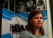 Editor Elena Milashina at the office of  Novaya Gazeta newspaper in Moscow. The pictures in the back commemorate Novaya Gazeta journalists killed at work. The newspaper is one of the few remaining independent media outlets in Russia that dare to challenge the Kremlin, but it has paid a heavy price for its courage. Anna Politkovskaya, the newspaper's most prominent journalist, was gunned down in her apartment block in Moscow in 2006.   ..Picture by Justin Jin.