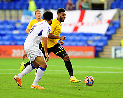 Bristol Rovers' Ellis Harrison is challenged by Tranmere Rovers's Marcus Holness - Photo mandatory by-line: Neil Brookman/JMP - Mobile: 07966 386802 - 08/11/2014 - SPORT - Football - Birkenhead - Prenton Park - Tranmere Rovers v Bristol Rovers - FA Cup - Round One