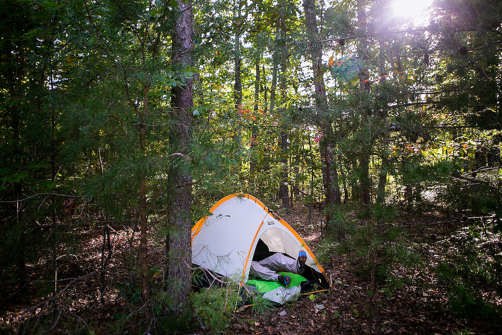 SPOTSYLVANIA, VA - OCTOBER 11, 2016: Jerome Libecki lies down to take a nap in his tent during the second day of the Quintuple Anvil race in Lake Anna State Park in Spotsylvania, Virginia. CREDIT: Sam Hodgson for The New York Times.