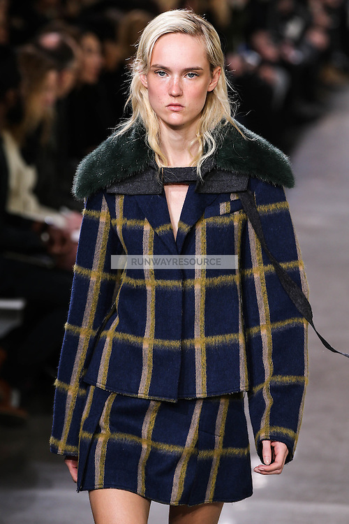 Harleth Kuusik walks the runway wearing Jason Wu Fall 2016, Hair by Paul Hanlon for Morocconoil, Makeup by Yadim for Maybelline, shot by Thomas Concordia during New York Fashion Week on February 12, 2016