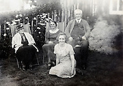 family various generation sitting and smiling 1900s