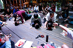 Chinese lesbians do pushups on each other as they play games during an interaction session on a cruise organised by the Parents and Friends of Lesbians and Gays (PFLAG) China organisation as they ship leaves Sasebo, Nagasaki, Japan, 16 June 2017. About 800 members of the Chinese LGBT (lesbian, gay, bisexual and transgender) community and their parents spent four days on a cruise trip organised by Parents and Friends of Lesbians and Gays (PFLAG) China, a grassroots non-government organisation, celebrating the 10th anniversary of the organisation. It aims to promote coexistence among homosexuals and their families.