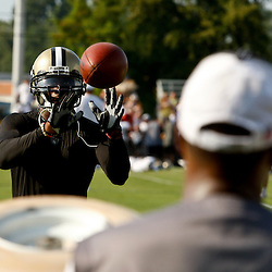 August 1, 2010; Metairie, LA, USA; New Orleans Saints safety Roman Harper (41) catches balls from the JUGS gun following a training camp practice at the New Orleans Saints practice facility. Mandatory Credit: Derick E. Hingle