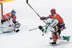 Bostjan Golicic (HDD Tilia Olimpija, #71) vs Jason Beckett (HK Acroni Jesenice, #7) during ice-hockey match between HK Acroni Jesenice and HDD Tilia Olimpija in fourth game of Final at Slovenian National League, on April 8, 2011 at Dvorana Podmezaklja, Jesenice, Slovenia. (Photo By Matic Klansek Velej / Sportida.com)