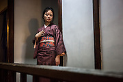 JAPAN, TOKYO Antique Kimono Oshima Tsumugi type from Amami Oshima in Okinawa. The kimono is made by woven natural brown hempy fabric, and the obi is red with embrodery flowers. June 2014