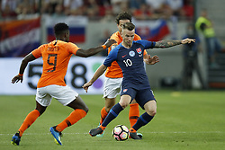 (L-R) Quincy Promes of Holland, Daryl Janmaat of Holland, Albert Rusnak of Slovakia during  the International friendly match between Slovakia and The Netherlands at Stadium Antona Malatinskeho on May 31, 2018 in Trnava, Slovakia