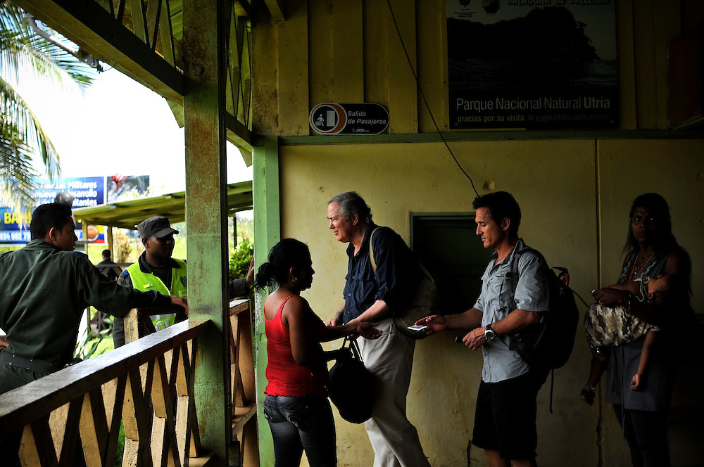 Gordon Radley, 64, (center) boards a plane to Quibdó from the small airport in Bahía Solano, Colombia. His brother Lawrence died on the same flight in the early 1960's when he was living in Colombia serving in the Peace Corps. Gordon Radley promised that he would someday retrace the last steps of his brother, and to complete the journey from Bahía Solano to Quibdó that his brother died trying to make.