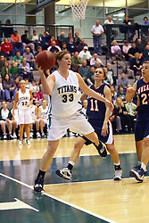 10 January 2009: Colleen Caplice steps on the baseline while attempting to save the ball from out of bounds. The Lady Titans of Illinois Wesleyan University downed the and Lady Thunder of Wheaton College by a score of 101 - 57 in the Shirk Center on the Illinois Wesleyan Campus in Bloomington Illinois.