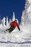 Callan Welder skis powder on blue sky day @ Big Mountain Resort in Whitefish Montana model released