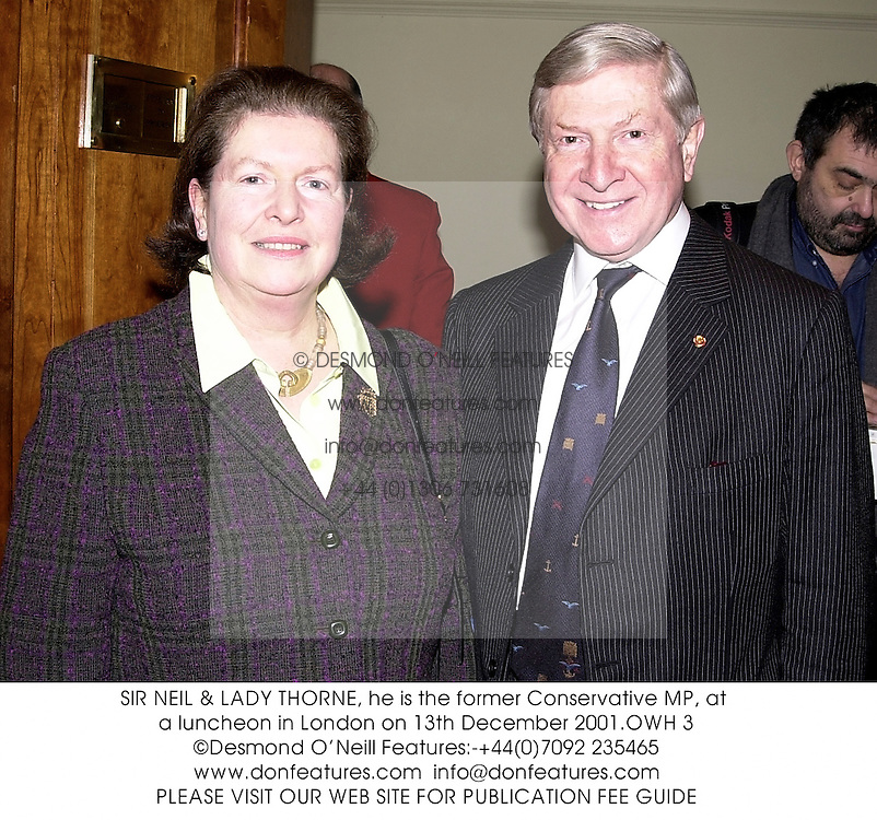 SIR NEIL & LADY THORNE, he is the former Conservative MP, at a luncheon in London on 13th December 2001.	OWH 3