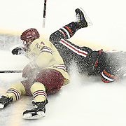 Bill Arnold #24 of the Boston College Eagles and John Stevens #18 of the Northeastern Huskies on the ice during The Beanpot Championship Game at TD Garden on February 10, 2014 in Boston, Massachusetts. (Photo by Elan Kawesch)