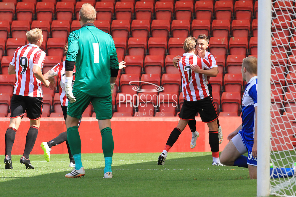 Harry Pell and Billy Waters celebrate the opening goal during the Pre-Season Friendly match between Cheltenham Town and Bristol Rovers at Whaddon Road, Cheltenham, England on 25 July 2015. Photo by Antony Thompson.