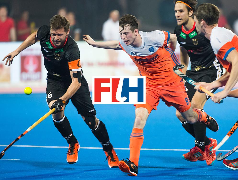 BHUBANESWAR - Seve van Ass (Ned) met Martin Haener (Ger)  tijdens de Hockey World League Finals , de kwartfinale wedstrijd Duitsland-Nederland (3-3).Duitsland wint na shoot-outs.    COPYRIGHT KOEN SUYK