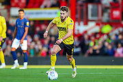 Millwall forward Tom Bradshaw (9) on the ball during the EFL Sky Bet Championship match between Brentford and Millwall at Griffin Park, London, England on 19 October 2019.