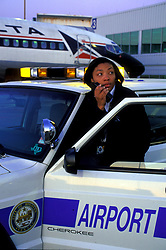 Stock photo of an airport security worker talking on her car radio at William P. Hobby Airport