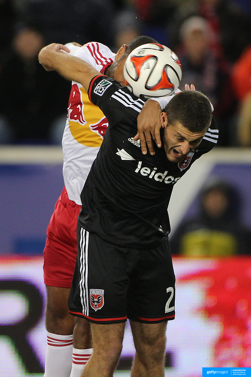 Thierry Henry, New York Red Bulls, challenges for a header with Chris Korb, DC United, during the New York Red Bulls V DC United, MLS Cup Playoffs, Eastern Conference Semifinals first leg at Red Bull Arena, Harrison, New Jersey. USA. 2nd November 2014. Photo Tim Clayton