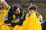Michael Fatialofa (L) and Ricky Riccitelli looking dejected on the bench during the Super Rugby match, Brumbies V Hurricanes, GIO Stadium, Canberra, Australia, 30th June 2018.Copyright photo: David Neilson / www.photosport.nz