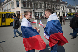 Crimea one day before the referendum. Young guys wearing the Russian federation flag stand together in Simferopol's Lenin Square. Simferopol, . Saturday, 15th March 2014. Picture by Daniel Leal-Olivas / i-Images