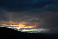 A fiery sunset lights the sky over Okanagan Lake, near Okanagan Centre, BC