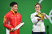 RIO DE JANEIRO, BRAZIL - AUGUST 15: China\'s Lyu Xiaojun, silver medalist of the Men\'s 77kg Group A weightlifting, exchanges gifts with the Olympic Organizing Committee on Day 10 of the Rio 2016 Olympic Games on August 15, 2016 in Rio de Janeiro, Brazil. <br /> ©Exclusivepix Media