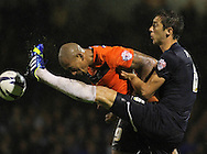 Picture by David Horn/Focus Images Ltd +44 7545 970036<br /> 13/09/2013<br /> Luke Prosser (right) of Southend United and Chris Iwelumo of Scunthorpe United during the Sky Bet League 2 match at Roots Hall, Southend.