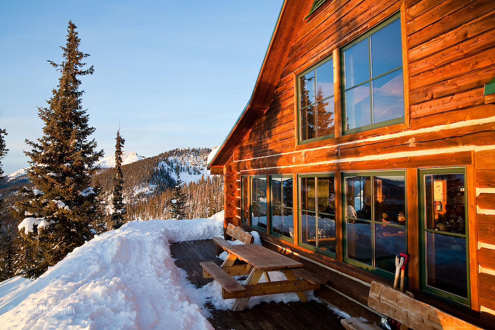 The Eiseman hut gets the last warm rays of sunlight during sunset in winter in Colorado.  Hut trips offer warm comfort, protection from the elements and provide all the ammenities so you only need to take a light pack on a ski tour.