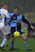 Photo Peter Spurrier.22/02/2003.Sport - Nationwide Football League Div 2.Wycombe Wanders v Wigan Athletic.Michael Simpson shield the ball from Gary Teale.