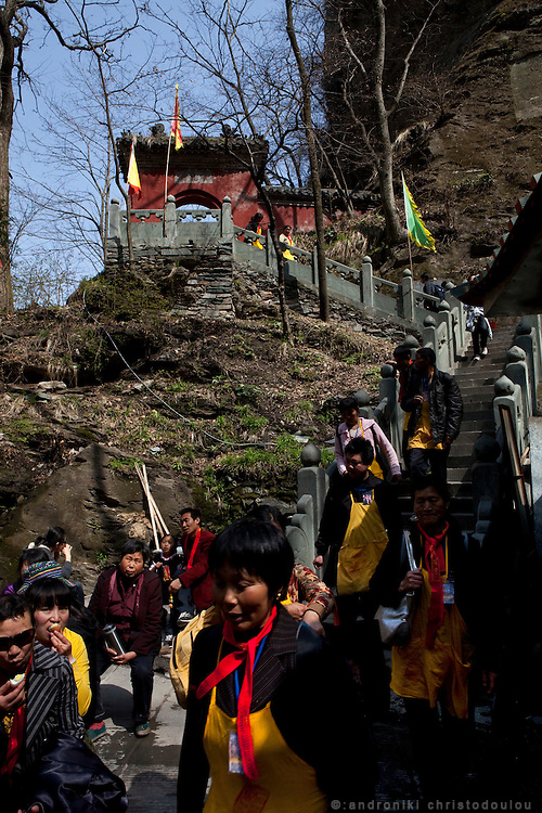 Asia, China, Hubei province.  Chinese pilgrims climbing the hundreds of steps and taking lunch breacks on Wudang moutain (Wudang-san), a World Heritage mountain with many Taoist monasteries.