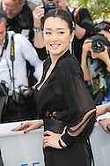 "CANNES, FRANCE - MAY 20:  Gong  Li attends the ""Coming Home"" photocall at the 67th Annual Cannes Film Festival on May 20, 2014 in Cannes, France.  (Photo by Tony Barson/FilmMagic)"