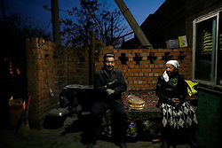 An ethnic Uighur couple are seen in a village in Turpan, Xinjiang Uighur Autonomous Province, China, 17 November 2017. Uighurs, a Muslim ethnic minority group in China, make up about 40 per cent of the 21.8 million people in Xinjiang, a vast, ethnically divided region that borders Pakistan, Afghanistan, Kazakhstan, Kyrgyzstan and Mongolia. Other ethnic minorities living in here include the Han Chinese, Kyrgyz, Mongolian and Tajiks people. Xinjiang has long been subjected to separatists unrests and violent terrorist attacks blamed by authorities on Islamist extremism while human rights groups say Chinese repression on religious rights, culture and freedom of movement caused undue tensions. Life however goes on under the watchful eye of the government for the ethnic Uighurs living in the city of Urumqi and surrounding areas and the region is still considered an attractive tourist spot. A recent report by state media Xinhua news agency claims Xinjiang received more than 100 million tourists in 2017, 'the highest figure in its history'.