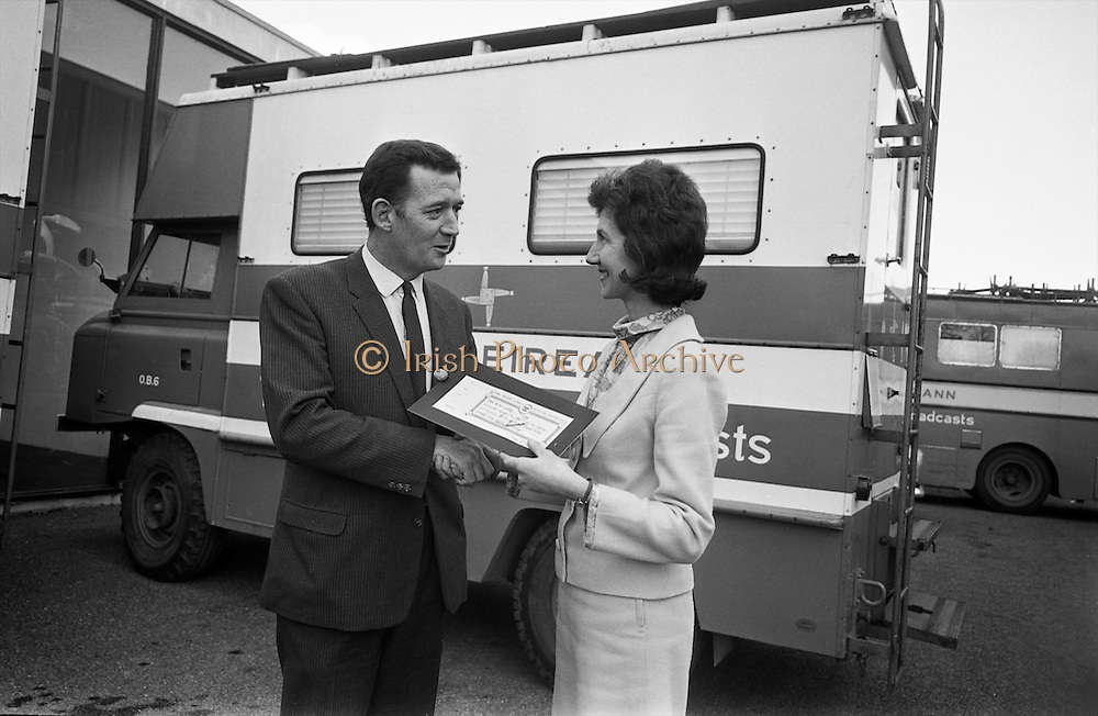 Popular TV and radio personality Bunny Carr inaugurating the campaign to obtain donors of bricks for the new Central Remedial Clinic's and Sheltered Workshops at Vernon Avenue, Clontarf, by purchasing the first certificate from Miss Emer Heagney, staff, Central Remedial Clinic..17.02.1967