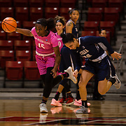 10 February 2018: The San Diego State Aztecs women's basketball team hosts Nevada on Play4Kay day at Viejas Arena. San Diego State Aztecs guard McKynzie Fort (15) steals the ball from a Nevada player in the second half. The Aztecs beat the Wolfpack 75-72.<br /> More game action at www.sdsuaztecphotos.com