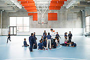 Baltimore, Maryland - March 07, 2014: Third-graders at Henderson-Hopkins exercise during P.E. in the school's new gymnasium. Eventually the gymnasium is one of the school's facility that will be open for members of the community to use. <br /> Henderson-Hopkins is a K-8 community school in East Baltimore. The school's library, gymnasium, auditorium, Early Childhood Center, and family resource center are open to the surrounding community. The school is funded through a partnership with Baltimore City, Johns Hopkins and the Harry and Jeanette Weinberg Foundation. <br /> CREDIT: Matt Roth for The New York Times<br /> Assignment ID: 30155200A