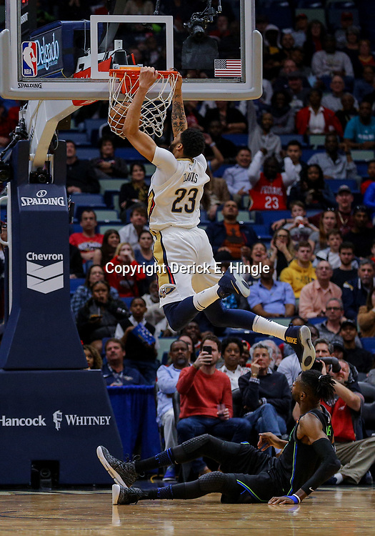 Mar 20, 2018; New Orleans, LA, USA; New Orleans Pelicans forward Anthony Davis (23) dunks against the Dallas Mavericks center Nerlens Noel (3) during the second quarter at the Smoothie King Center. Mandatory Credit: Derick E. Hingle-USA TODAY Sports