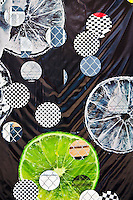 New York, New York City. Fence graphic against lemon slice, dark background.