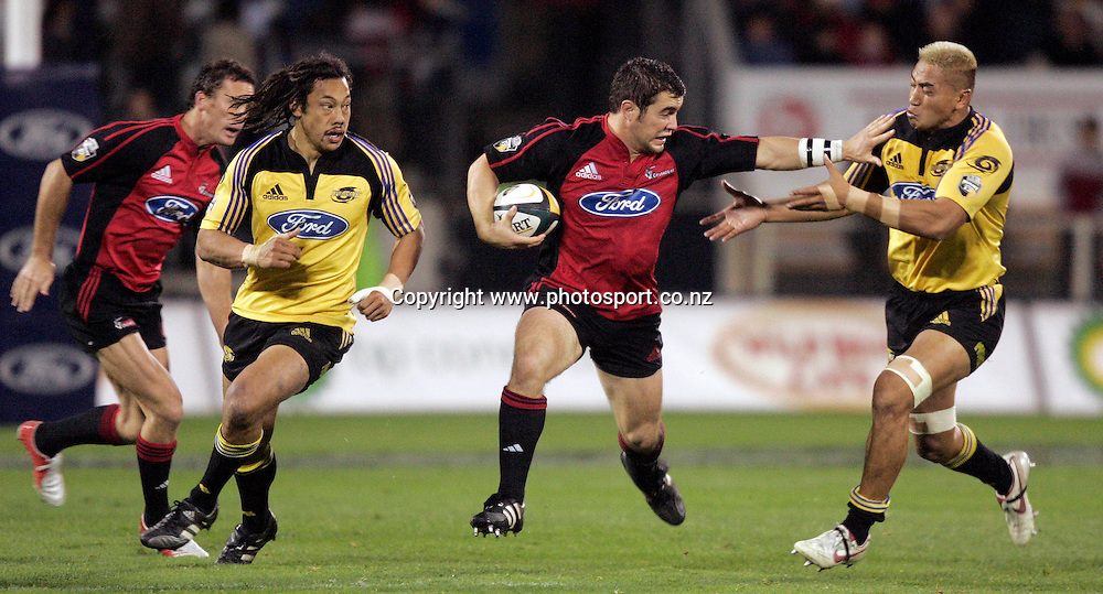 20/5/2005. Crusaders hooker Corey Flynn pushes away Jerry Collins(R)as Caleb Ralph and Tana Umaga look on during the Super 12 semi final clash at Jade Stadium in Christchurch on Friday night. Photo: PHOTOSPORT