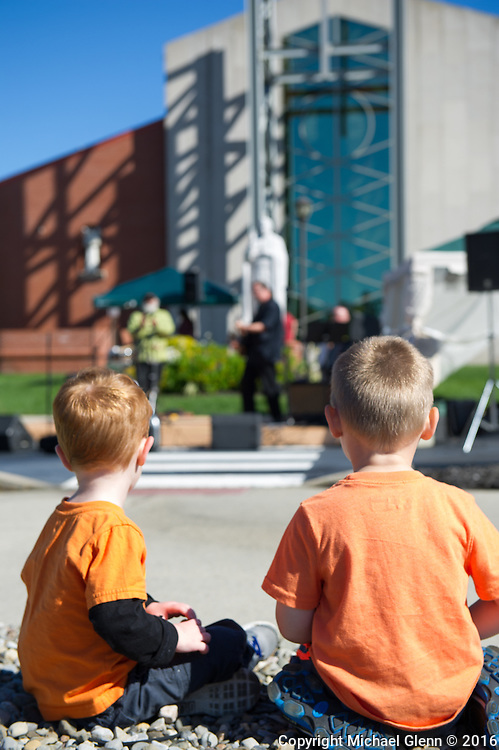 15 Oct. 2016 Forked River USA / Michael and Robert watch and listen as the Spritus band plays as St Pius X celebrates it's 10th year in their new church with a festival open to all  /  Michael Glenn  / Glenn Images